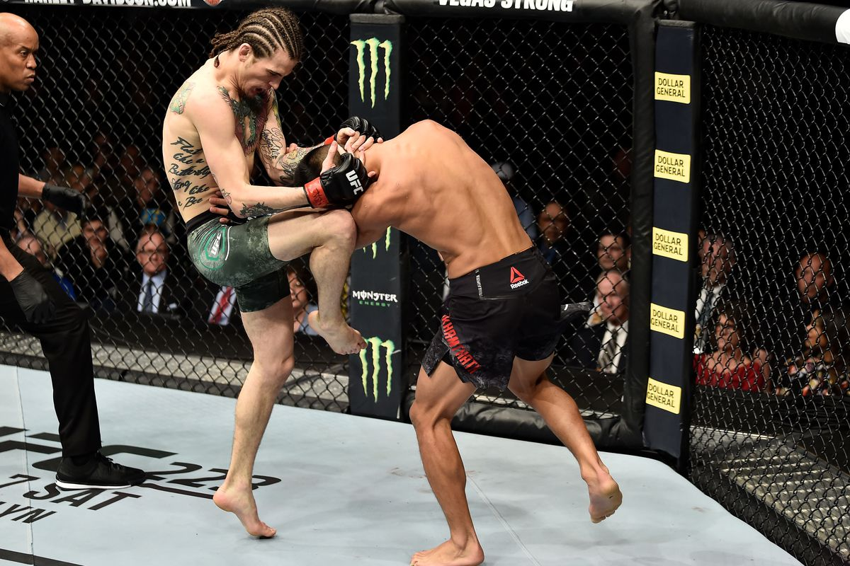 Sean O'Malley knees Andre Soukhamthath in their bantamweight bout during the UFC 222 event inside T-Mobile Arena on March 3, 2018 in Las Vegas, Nevada.