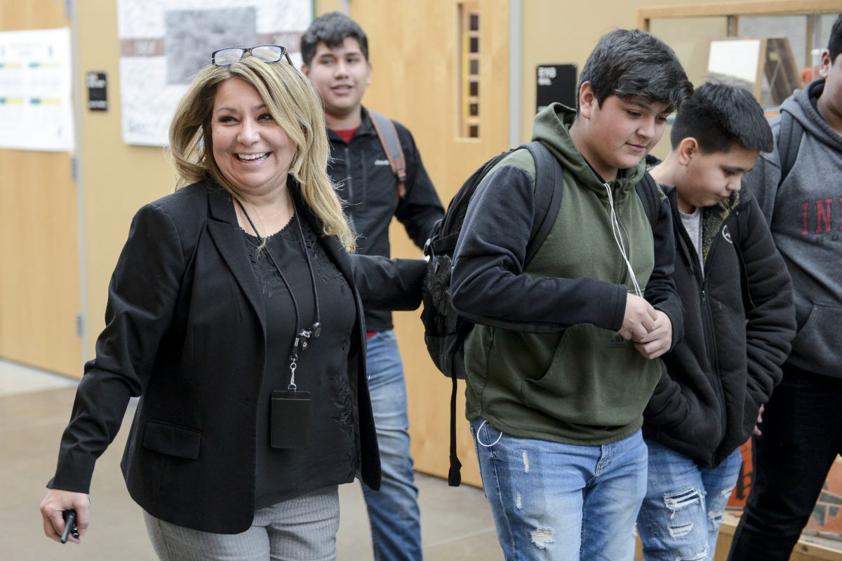 Adams City High School principal Gabriella Maldonado jokes with students in the hallway Monday, Feb. 4, 2019 in Commerce City, Colorado.