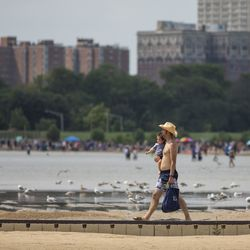 People cool off at Montrose Beach on the North Side during a heat wave, Friday afternoon, July 19, 2019.