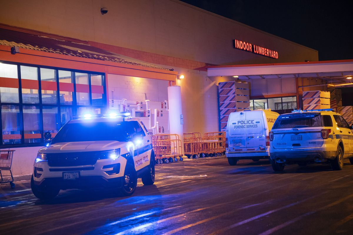 Chicago police respond to the scene where two people were found with gunshot wounds at a Home Depot in the 200 block of West 87th Street in West Chatham on the South Side, Thursday, Jan. 28, 2021.