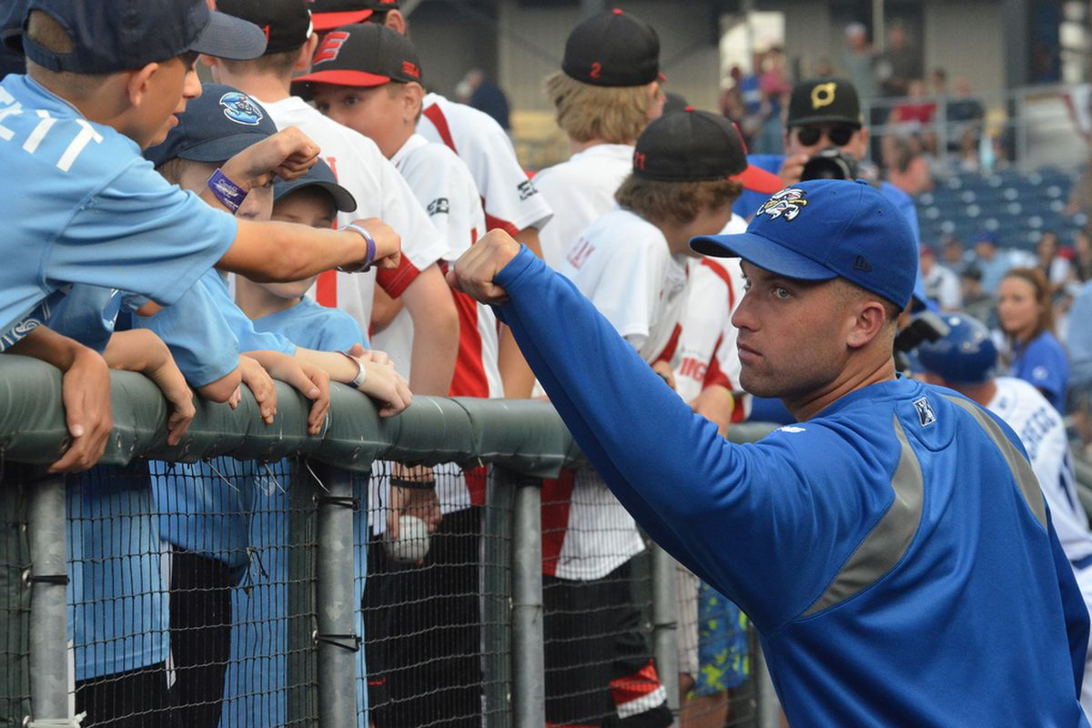 Danny Duffy fist bumps a young fan in Omaha