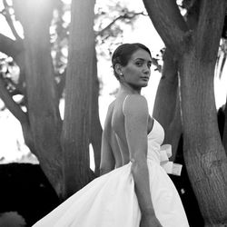 """""""I wanted nothing more than to have fun on my wedding day. I was a young bride and wanted a dress that was modern with classic elements and something that made me feel special. The second I put on this dress by Amsale I said, 'I feel like a present!'"""""""