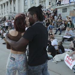 A couple wanting to remain anonymous kiss as skateboarders protest at the Utah State Capitol during an event called Skate for Solidarity in Salt Lake City on Thursday, June 11, 2020. The protesters joined others across the nation to decry racism and police brutality after the death of George Floyd, a black man who died while being taken into custody by police in Minneapolis.