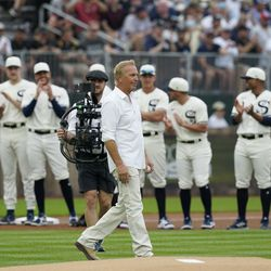 Actor Kevin Costner walks to the stands before a baseball game between the New York Yankees and Chicago White Sox, Thursday, Aug. 12, 2021 in Dyersville, Iowa. The Yankees and White Sox are playing at a temporary stadium in the middle of a cornfield at the Field of Dreams movie site, the first Major League Baseball game held in Iowa.