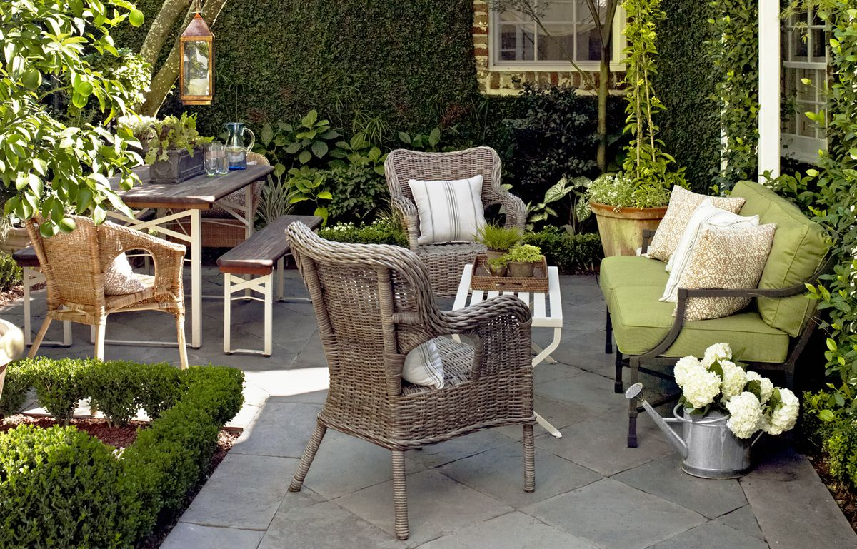 Patio with sofa, outdoor arm chairs, and coffee table.