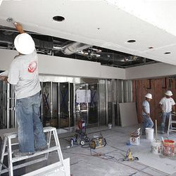 Construction crews work in the retail store area of BYU's creamery, which will become the Culinary Support Center.