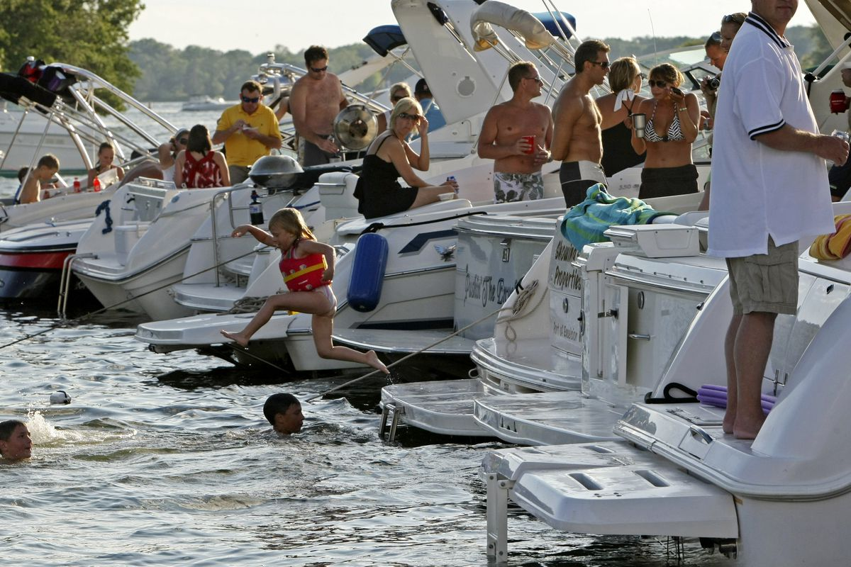 BRUCE BISPING • bbisping@startribune.com Lake Minnetonka, MN., Friday, 7/24/2009] Boaters gathered at the big screen set up on Big Island for the annual boat-in-theatre sponsored by Marine Max. Many in the Brainerd Lakes area are concerned that they