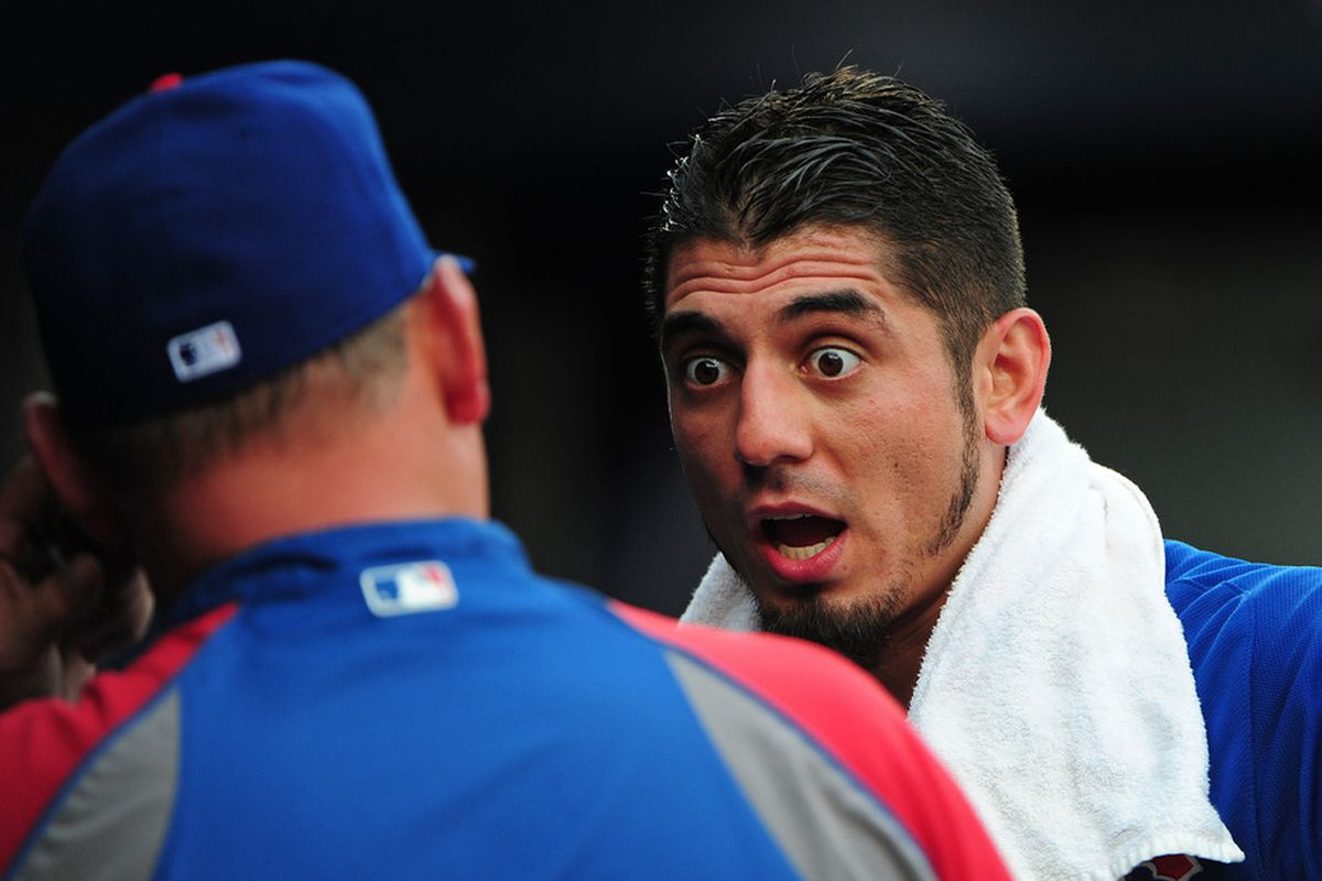 What is Matt thinking here? Matt Garza of the Chicago Cubs has a discussion with Pitching Coach Chris Bosio during a game against the Atlanta Braves at Turner Field in Atlanta, Georgia. (Photo by Scott Cunningham/Getty Images)