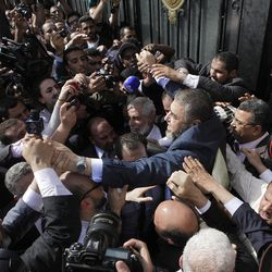 FILE - In this April 5, 2012 file photo, Egypt's  Muslim Brotherhood candidate for presidency Khairat el-Shater, right, is surrounded by hundreds of supporters after he submitted his candidacy papers at the Higher Presidential Elections Commission, in Cairo, Egypt. he presidential election scheduled in May will mark the beginning of a handover of power by the ruling military to an elected civilian, following last year's popular uprising that overthrew Hosni Mubarak.(AP Photo/Amr Nabil, File)