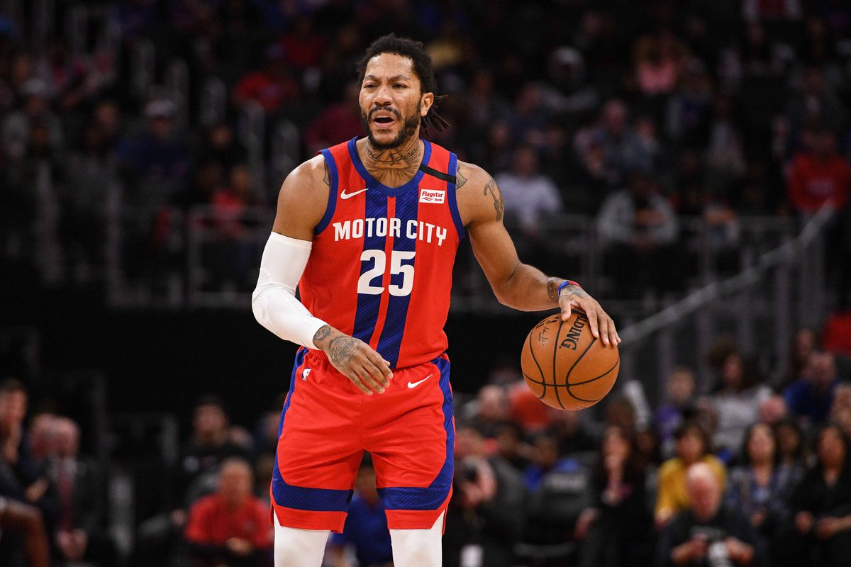 Detroit Pistons guard Derrick Rose brings the ball up court during the first quarter against the Denver Nuggets at Little Caesars Arena.