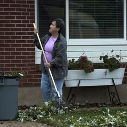 """Vicky Frost cleans up debris left in her yard after a tornado struck Washington Terrace on Thursday, Sept. 22, 2016. """"I was pretty lucky,"""" Frost said. """"In the six years I've lived here, I've never seen anything this bad."""""""