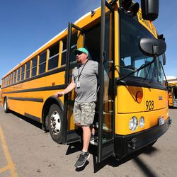 Driver Chris Stevenson exits a bus in American Fork on Friday, March 17, 2017. Alpine School District has added monitors and cameras on its buses to create a safe bus culture to help with bullying.