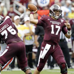 Mississippi State quarterback Tyler Russell (17) throws a short pass as teammate offensive linesman Blaine Clausell (75) blocks in the first quarter of their NCAA college football game in Starkville, Miss., Saturday, Sept. 8, 2012.