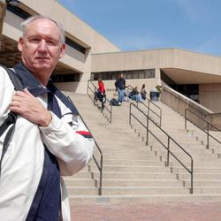 Donald Vitkus poses outside the George E. Frost building at Holyoke Community College in Holyoke, Mass. on April 12, 2004. Vitkus, 60, a longtime factory worker who was laid off, plans to obtain a degree in human services by next January.