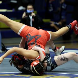 Brooklyn Pace of Copper Hills takes down Arleth Antonio of Granger as they wrestle in class 115 as girls compete for the 6A State Wrestling championship at West Lake High in Saratoga Springs on Monday, Feb. 15, 2021.