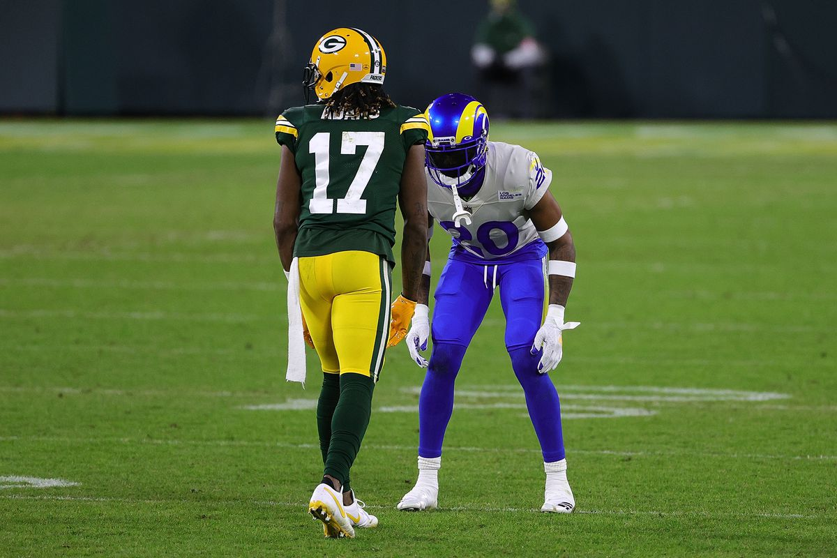 Davante Adams #17 of the Green Bay Packers is defended by Jalen Ramsey #20 of the Los Angeles Rams during the NFC Divisional Playoff game at Lambeau Field on January 16, 2021 in Green Bay, Wisconsin. The Packers defeated the Rams 32-18.