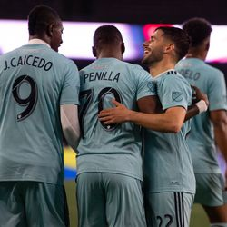FOXBOROUGH, MA - APRIL 20: New England Revolution midfielder Carles Gil #22 hugs forward Cristian Penilla #70 after Penilla's goal against the New York Red Bulls at Gillette Stadium on April 20, 2019 in Foxborough, Massachusetts. (Photo by J. Alexander Dolan - The Bent Musket)