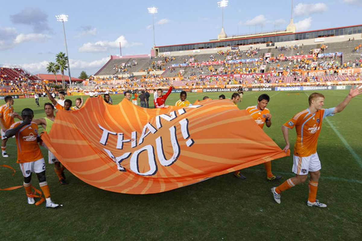 HOUSTON - OCTOBER 23:  Houston Dynamo salute the fans on  fan appreciation day as they play the Seattle Sounders at Robertston Stadium on October 23 2010 in Houston Texas. Houston won 2-1.  (Photo by Bob Levey/Getty Images)