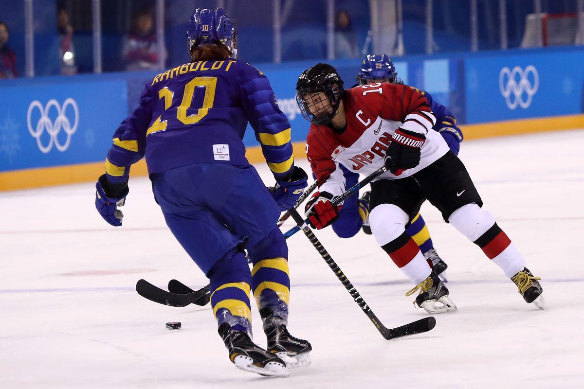 Chiho Osawa #12 of Japan skates against Fanny Rask #20 of Sweden