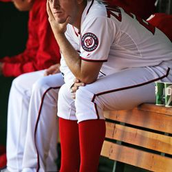 Washington Nationals starting pitcher Jordan Zimmermann pauses in the dugout during a baseball game against the Milwaukee Brewers at Nationals Park, Monday, Sept. 24, 2012, in Washington. The Nationals won 12-2.