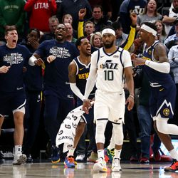 Denver Nuggets players celebrate as they defeat the Utah Jazz in an NBA basketball game at Vivint Arena in Salt Lake City on Wednesday, Feb. 5, 2020. Denver won 98-95, giving the Jazz their fifth straight loss.