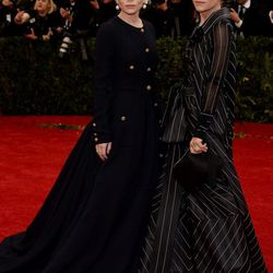 Mary-Kate in vintage Ferre and Ashley Olsen in vintage Chanel
