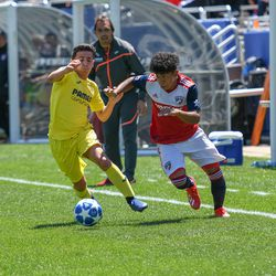 Kevin Bonilla (12) racing to the ball during the opening match of the 40th Annual Dallas Cup.