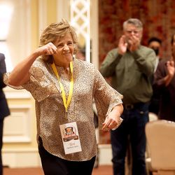 Collegiate track all-American Teri Okelberry Spiers pumps her fist as she is honored at the Utah Sports Hall of Fame banquet at the Little America Hotel in Salt Lake City on Monday, Sept. 20, 2021.