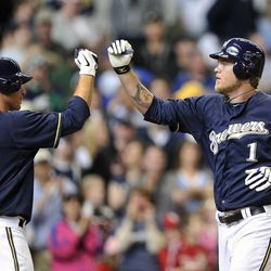 Milwaukee Brewers' Mat Gamel (24) congratulates Corey Hart (1) after Hart's solo home run against the St. Louis Cardinals during the fifth inning of a baseball game, Sunday, April 8, 2012, in Milwaukee.