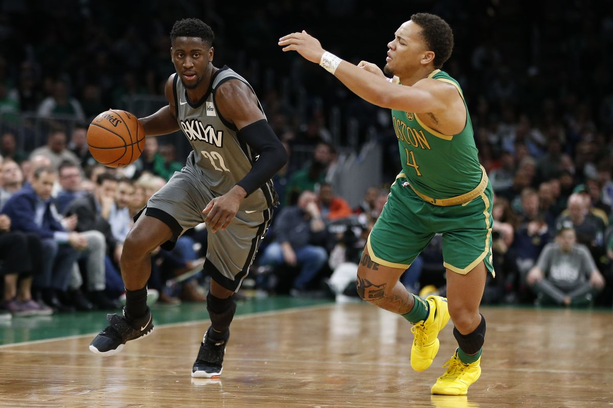 Brooklyn Nets guard Caris LeVert drives against Boston Celtics point guard Carsen Edwards during overtime at TD Garden.