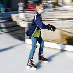 A little boy skates at the new Bountiful Ice Ribbon during its grand opening at Bountiful Town Square in Bountiful on Saturday, Dec. 5, 2020.