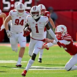 Aron Cruickshank (#1) breaks the tackle from the Nebraska kicker on his way to an 89 yard TD return. The TD would quickly tie the game after Nebraska's opening touchdown. It would be Aron's 2nd career TD.