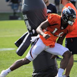 Rookie WR for the Broncos Courtland Sutton moves past the pads during position drills.
