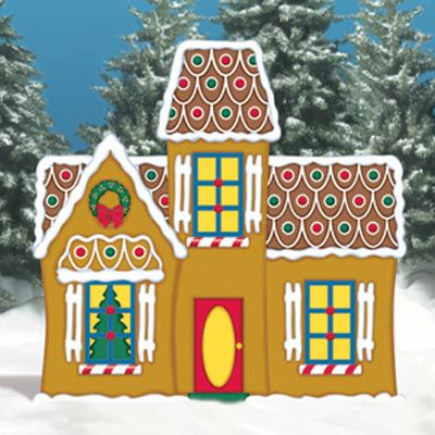 Gingerbread house made of wood being used as a yard decoration for the holidays.