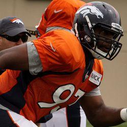 Broncos DE Jeremy Beal runs to make a play