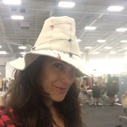 <strong>3:40pm</strong> I can't help myself. I have to try on hats by Yestadt Millenary. I adore this summer beach hat.