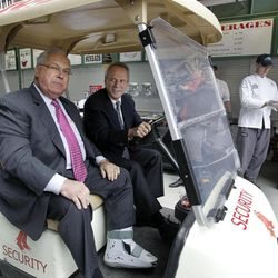 Boston Red Sox President and CEO Larry Lucchino, right, drives Boston Mayor Thomas Menino in a cart for a tour at Fenway Park in Boston on Monday, April 9, 2012. The Red Sox's baseball home opener is Friday.