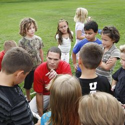 Former Ute Cal Beck teaches his third-grade class about teamwork at Parkside Elementary School in August.