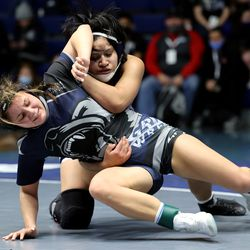 Marquize Salguero of Copper Hills and Neida Valle of Hunter, wrestle in class 128 as girls compete for the 6A State Wrestling championship at West Lake High in Saratoga Springs on Monday, Feb. 15, 2021.