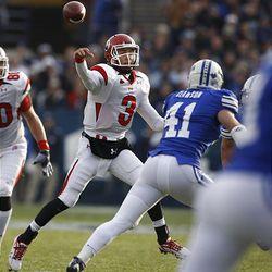 Utah quarterback Jordan Wynn (3) throws the ball downfield as Brigham Young University plays against Utah at LaVell Edwards Stadium in Provo, Utah, Saturday.