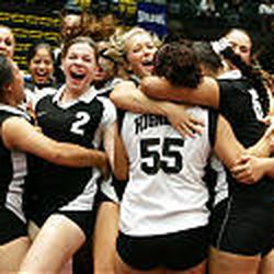 Highland's volleyball team erupts in celebration after beating Cottonwood for the 4A state championship Saturday in Orem.