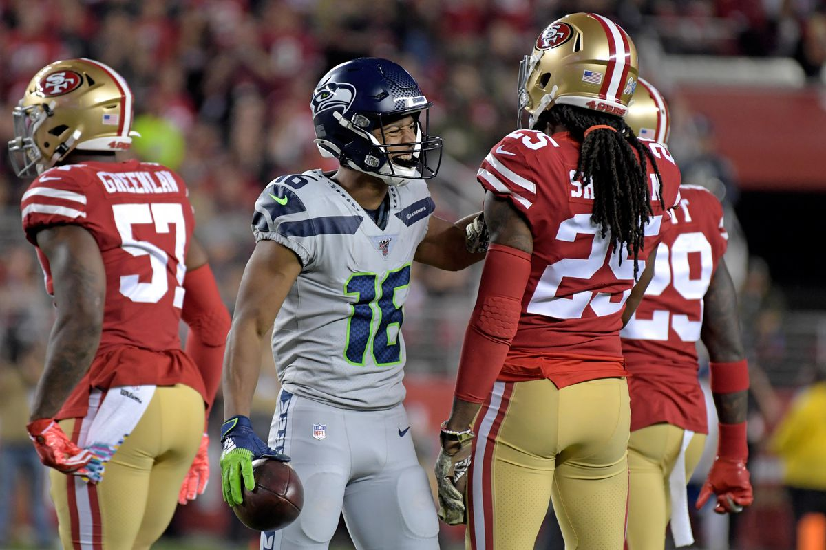 Seattle Seahawks wide receiver Tyler Lockett exchange words with San Francisco 49ers cornerback Richard Sherman during the first half at Levi's Stadium.