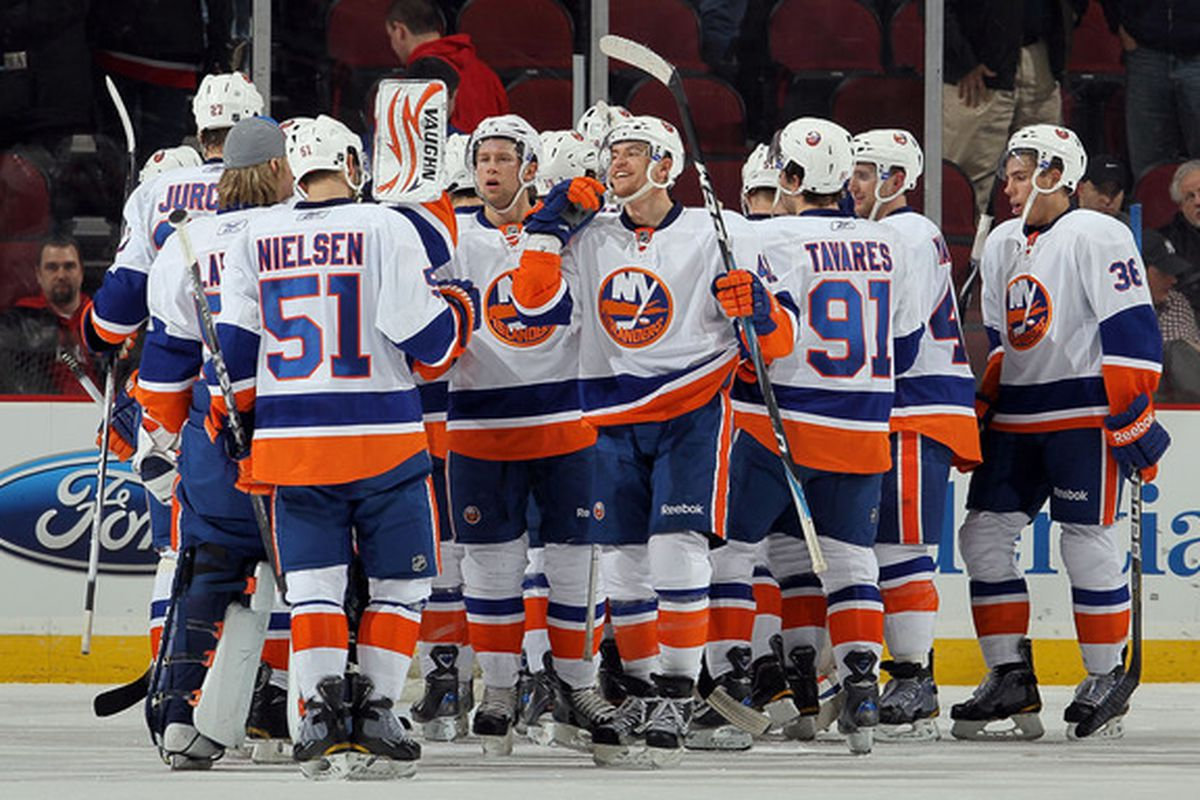 NEWARK NJ - DECEMBER 23:  The New York Islanders celebrate after defeating the New Jersey Devils at the Prudential Center on December 23 2010 in Newark New Jersey. The Isles defeated the Devils 5-1.  (Photo by Jim McIsaac/Getty Images)