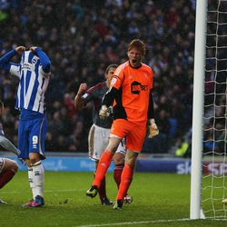 BRIGHTON, ENGLAND - NOVEMBER 24: Adam Bogdan of Bolton Wanderers celebrates saving a penalty from Ashley Barnes of Brighton & Hove Albion during the npower Championship match between Brighton & Hove Albion and Bolton Wanderers at Amex Stadium on November