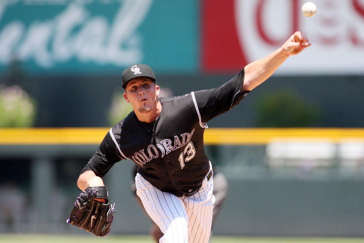 July 15, 2012; Denver, CO, USA; Colorado Rockies pitcher Drew Pomeranz (13) delivers a pitch during the first inning against the Philadelphia Phillies at Coors Field.  Mandatory Credit: Chris Humphreys-US PRESSWIREi