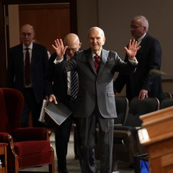 President Russell M. Nelson waves prior to the Sunday afternoon session of the 190th Annual General Conference of The Church of Jesus Christ of Latter-day Saints in Salt Lake City on Sunday, April 5, 2020.