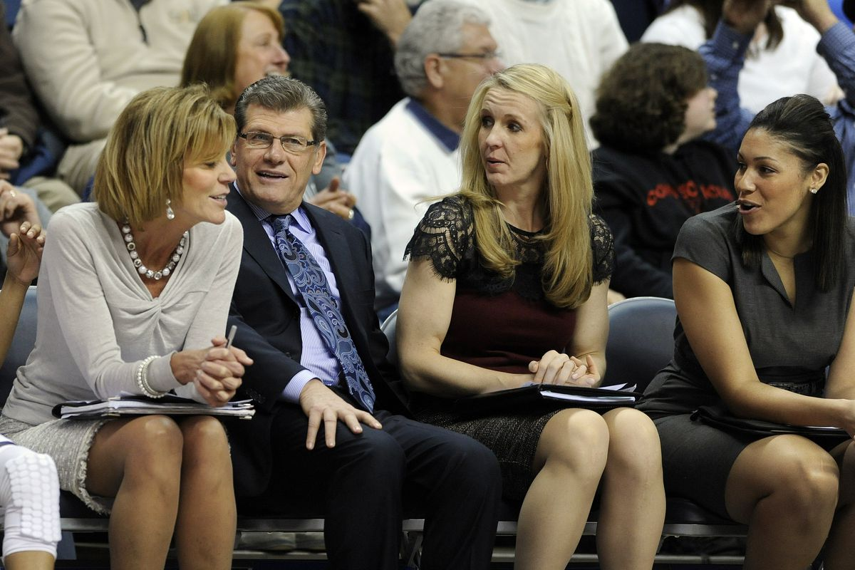 Connecticut head coach Geno Auriemma sits on the bench with associate head basketball coach Chris Dailey, left, and assistant coaches Shea Ralph, second from right, and Marisa Moseley during a 2014 game.