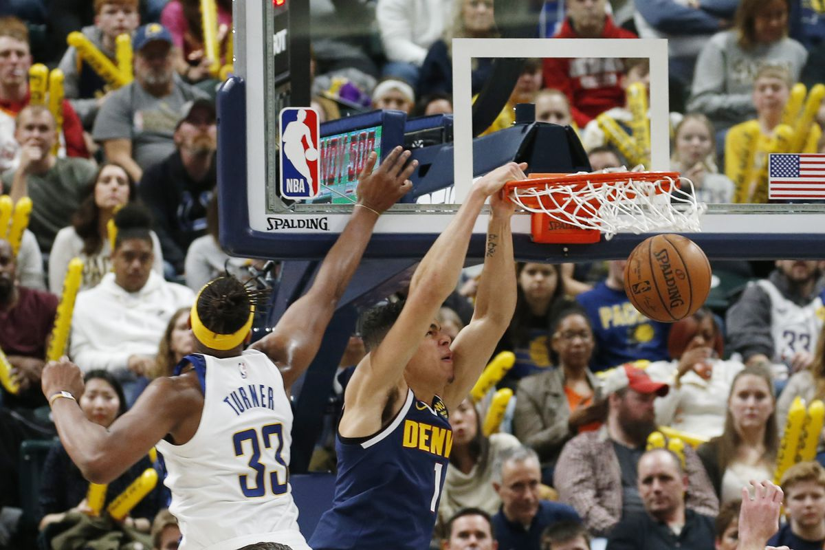Denver Nuggets forward Michael Porter Jr. dunks the ball against Indiana Pacers center Myles Turner during the third quarter at Bankers Life Fieldhouse.