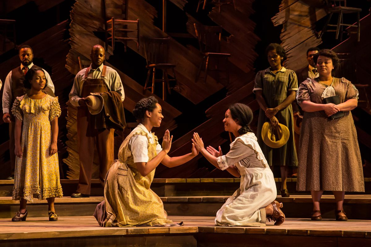 """Adrianna Hicks (as Celie, left) and N'Jameh Camara (as Nettie) and the cast of """"The Color Purple.""""   Matthew Murphy"""