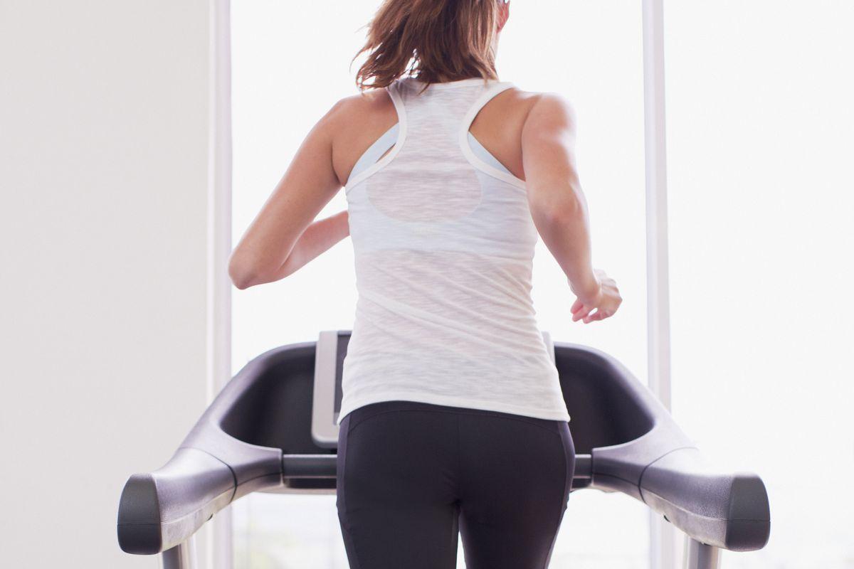 Woman running on treadmill.